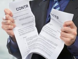 Unrecognizable businessman tearing the contract papers